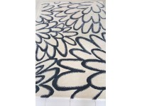 Hand tufted Bow rug. 3 sizes